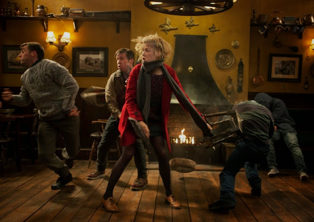Rosamund Pike looks like she's cosplaying as the Fourth Doctor in this fight scene. Too bad Brad Allan didn't get her to use that scarf as a weapon. That would have been bomb.