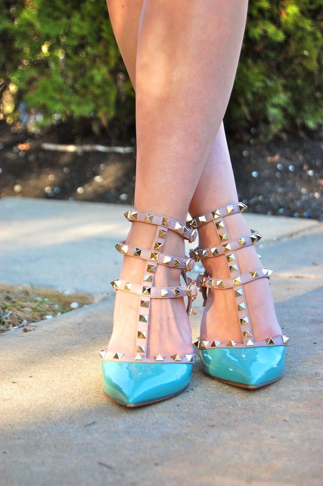 Wearing blue Valentino Rockstud kitten heels