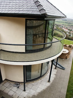 Curved Glass doors and balcony