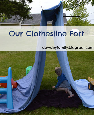 Reading outside in a clothesline fort