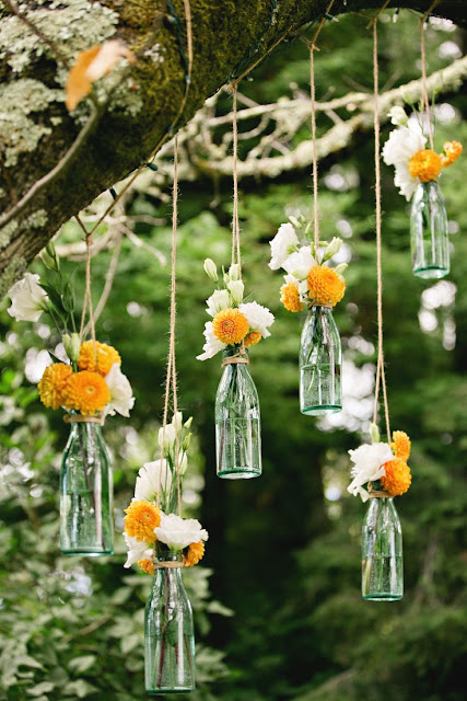 hanging vases with fresh spring flowers