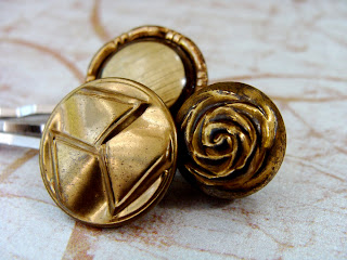 hair pins with textured golden buttons used for hair accessorizing