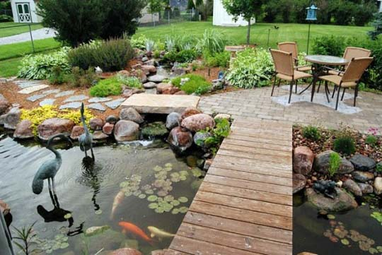 Natural backyard design ideas with pond home decorating for Small pond house plans