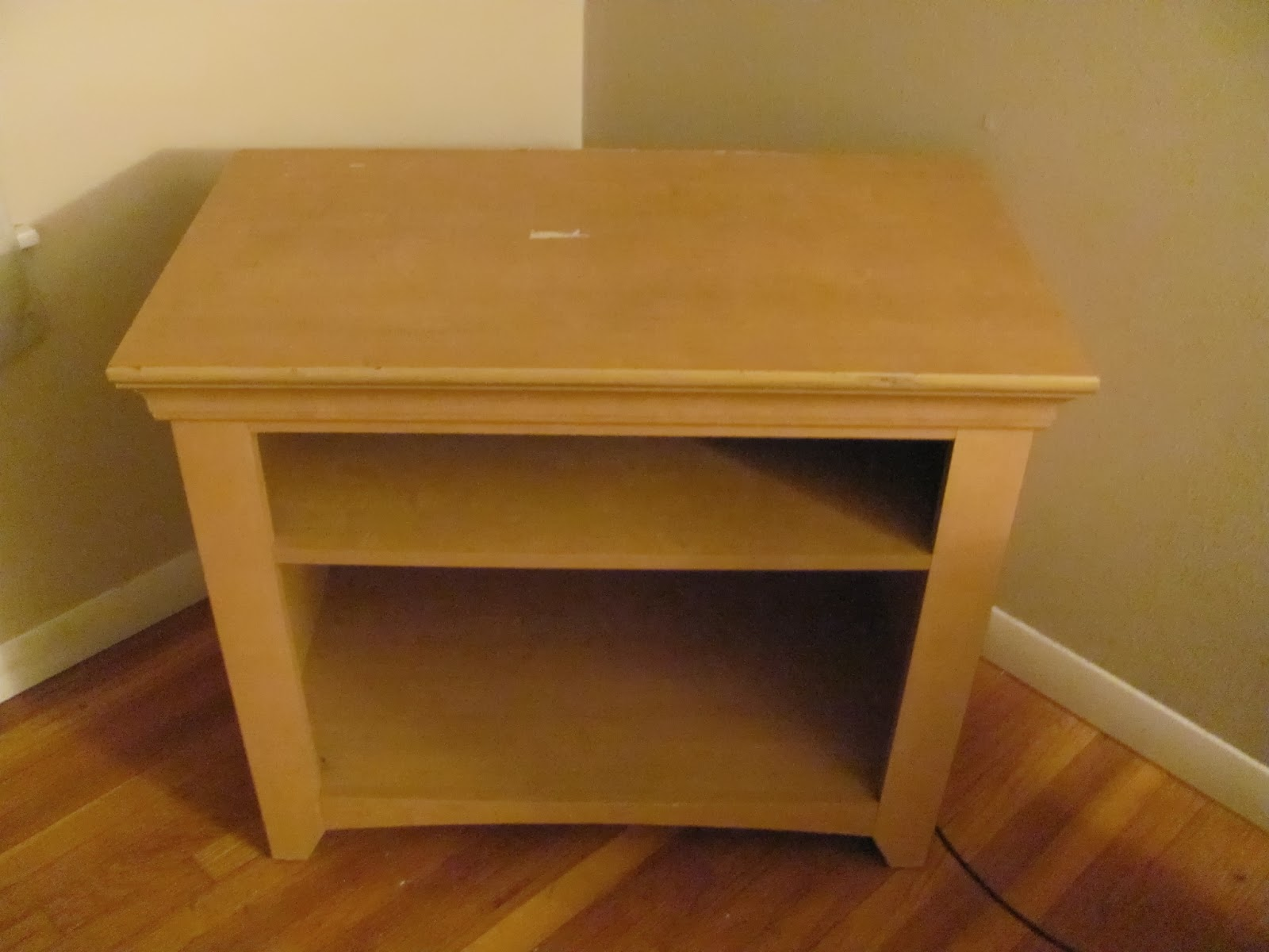 Tan TV stand on display before being sold on Craigslist