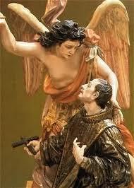 San Juan de Dios de rodillas con el Arcangel san Rafael a su lado