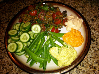 Lentil salad with cucumbers, sugar snap peas and hummus trio for lunch