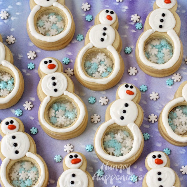 Snowflake Filled Snowman Cookies are decorated with White Candy Melts and Snowflake Sprinkles from http://www.hungryhappenings.com