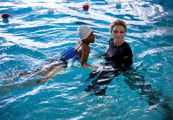 Princess Charlene of Monaco attended a activity supported from her founding at the St. Charles College's pool
