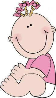 bebita con lacitos rosas en el pelo