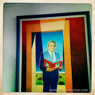 The painting hangs at his Libros Para Todos book publishing company
