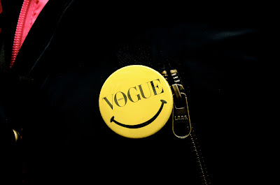 Candid street style at Paris, France, Vogue Nippon yellow pin
