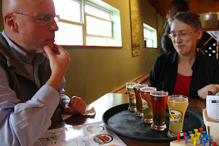 Rick and Joy debating which was their favorite beer at Union Barrel Works