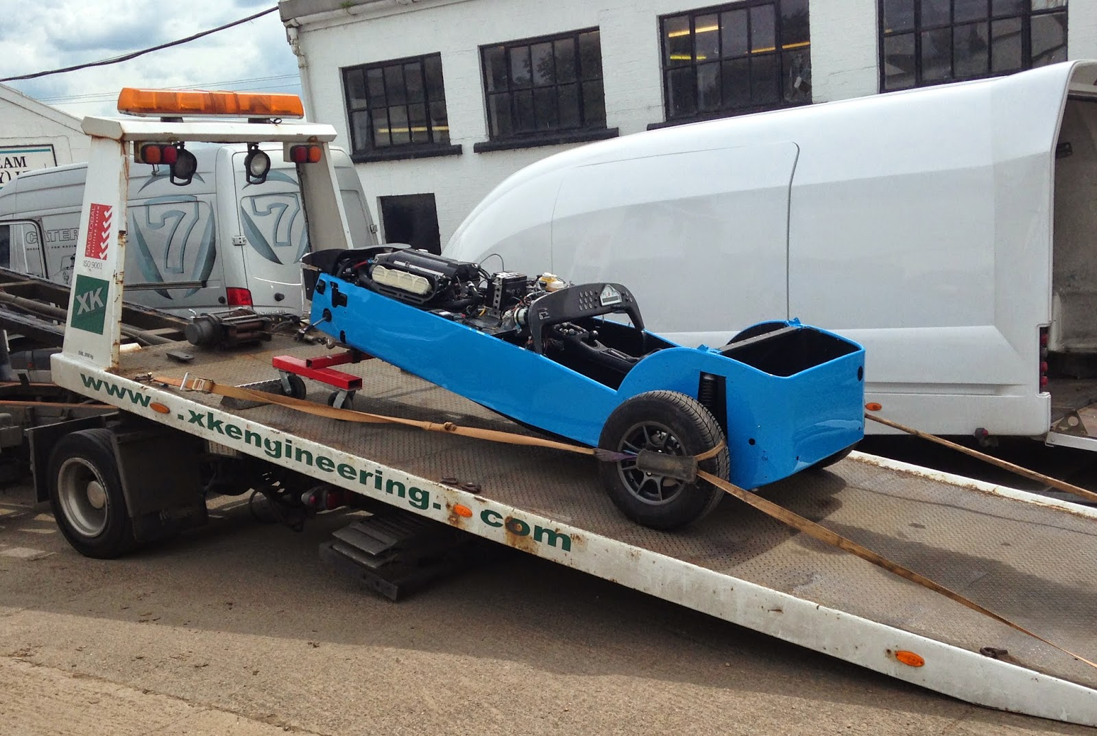 My Caterham R500 on XK engineering flat bed lorry after re-painting.
