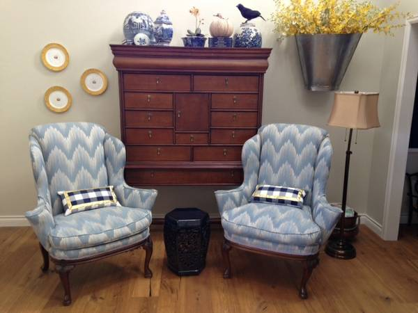 The Flared Arms Certainly Give These Chairs A Dose Of Flair Pale Blue