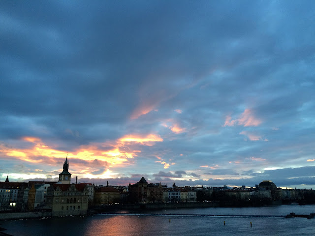 view from charles bridge in prague at sunrise