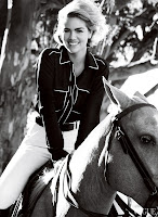 Kate Upton riding a horse