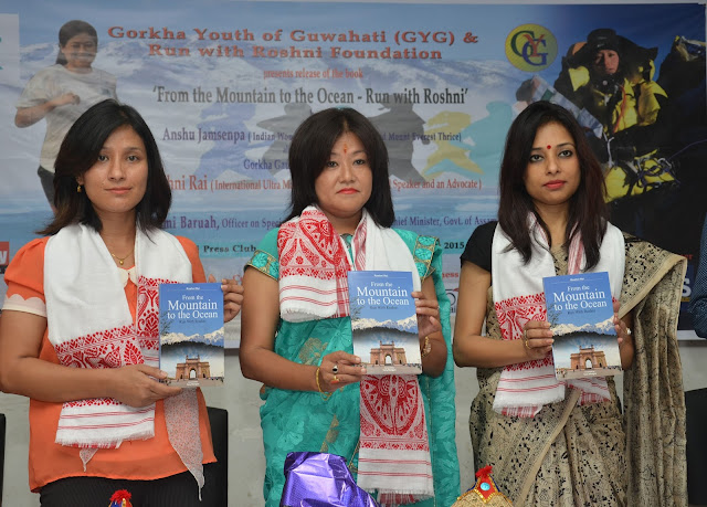 Anshu Jamsenpa (L) Mountaineer who climed Mount Everest thrice and Pomi Baruah (R) OSD to CM, Govt. of Assam relaesing Roshni rai's book at Gauhati Press Club on saturday.jpg