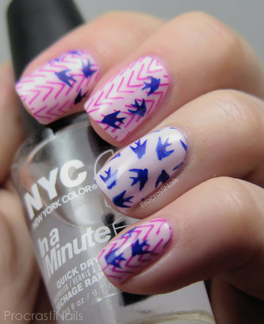 Nail art featuring pink chevrons with blue birds stamped on top