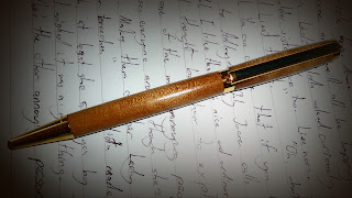 The beautiful pen my little brother made me, sitting right on top of my writing.