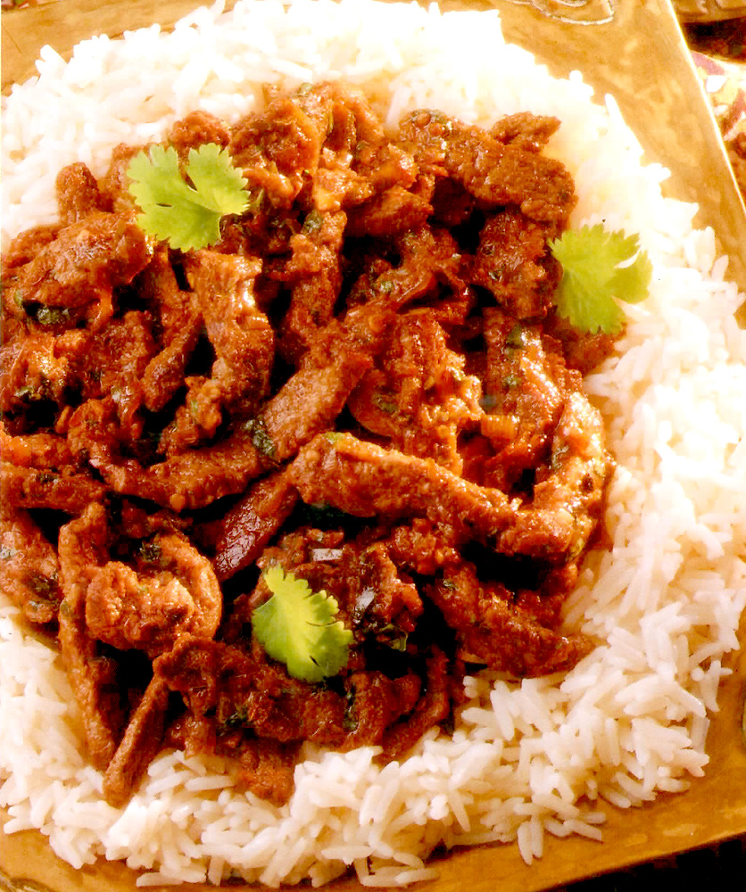 Celtnet recipes blog thai green curry of beef recipe thai green curry of beef served on a bed of rice forumfinder Image collections