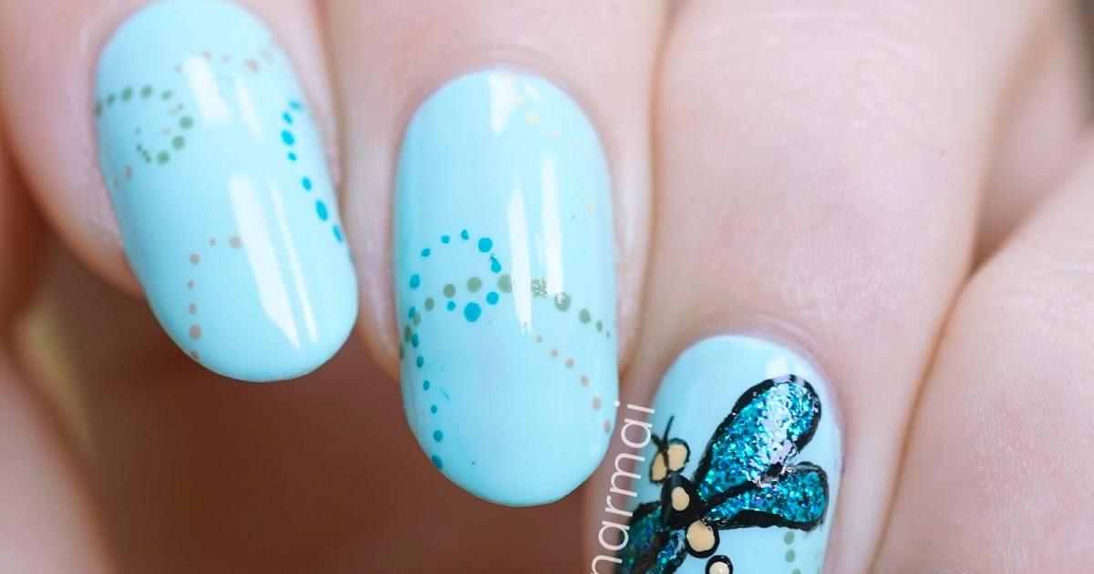 - PiggieLuv: Glitter Dragonfly Nail Art