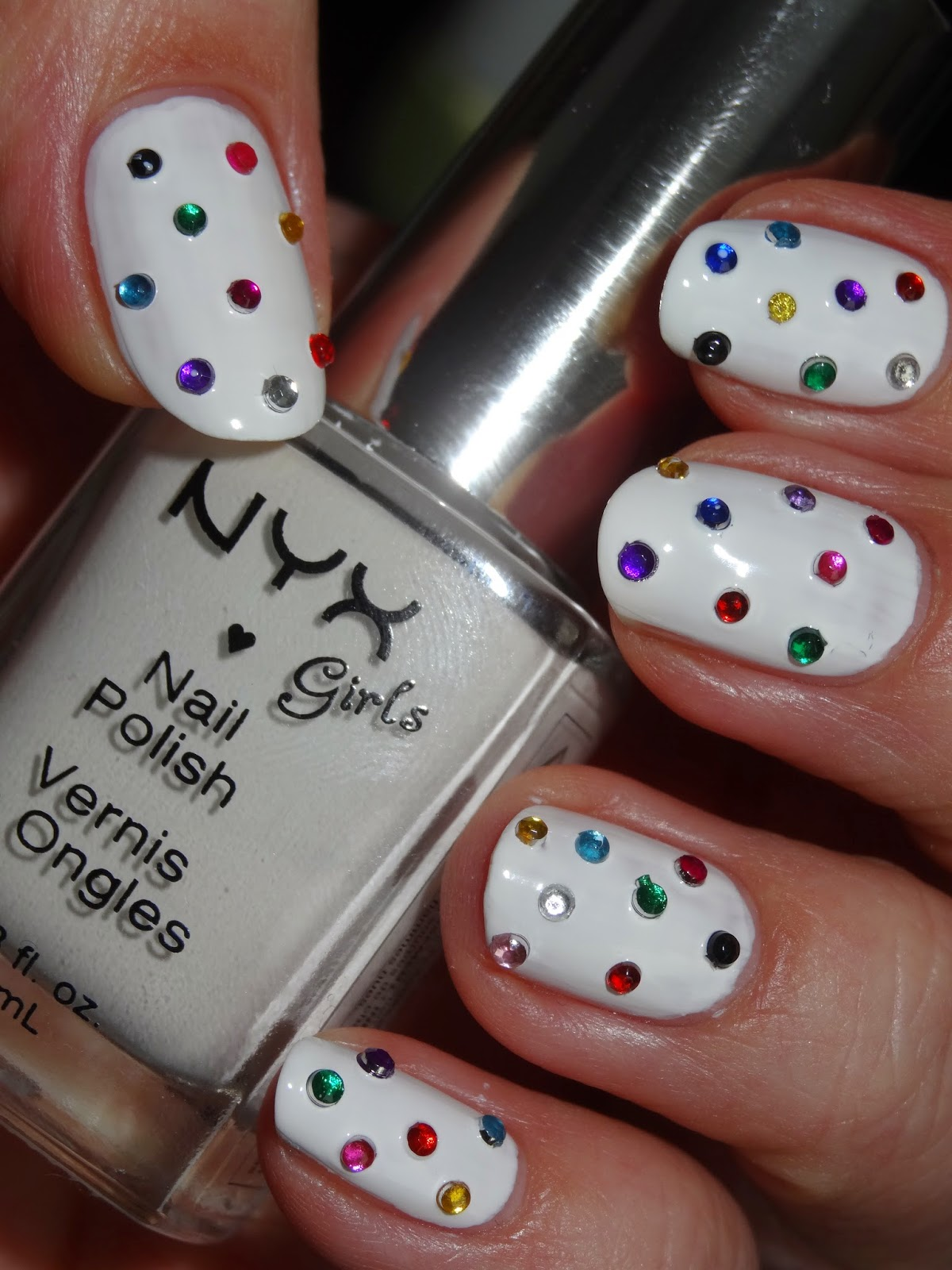 polishlover louis vuitton inspired rhinestone manicure for spring it had the white louis vuitton pattern on it and i thought this might make a great spring summer manicure let me show you what i came up with