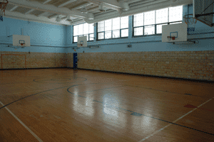 Inside youth sports basketball court surfaces and shoe tips for Indoor basketball court construction
