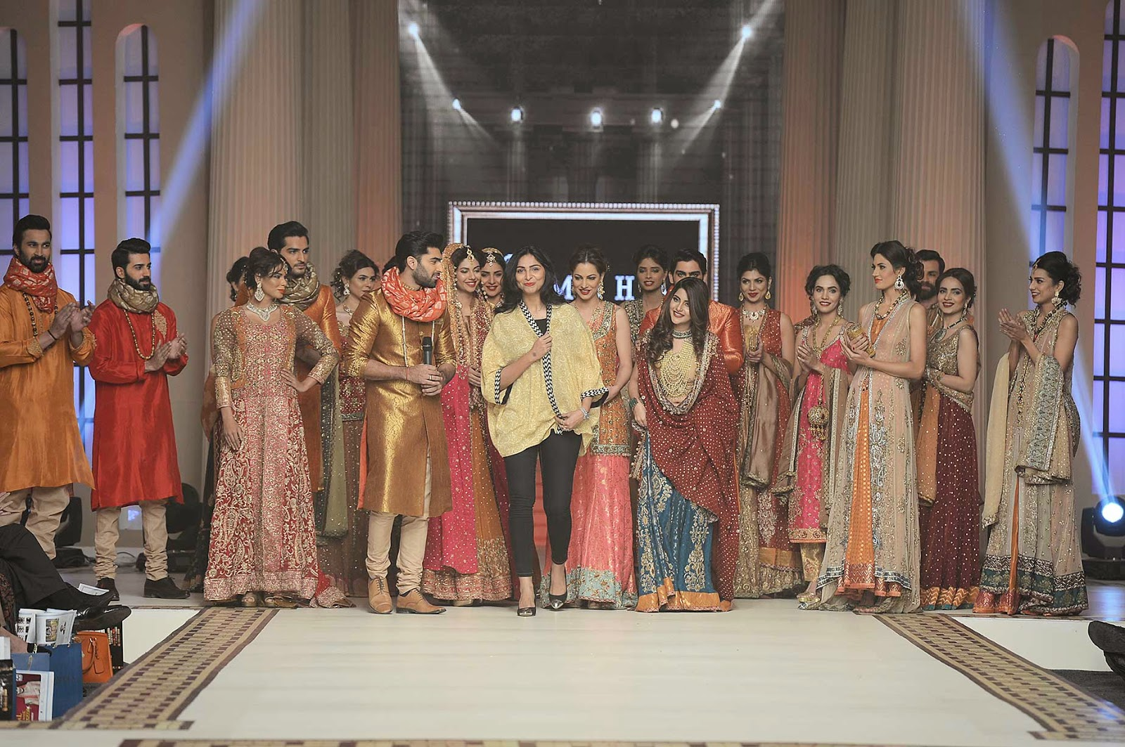 uzma babar with all the models at the end of her show