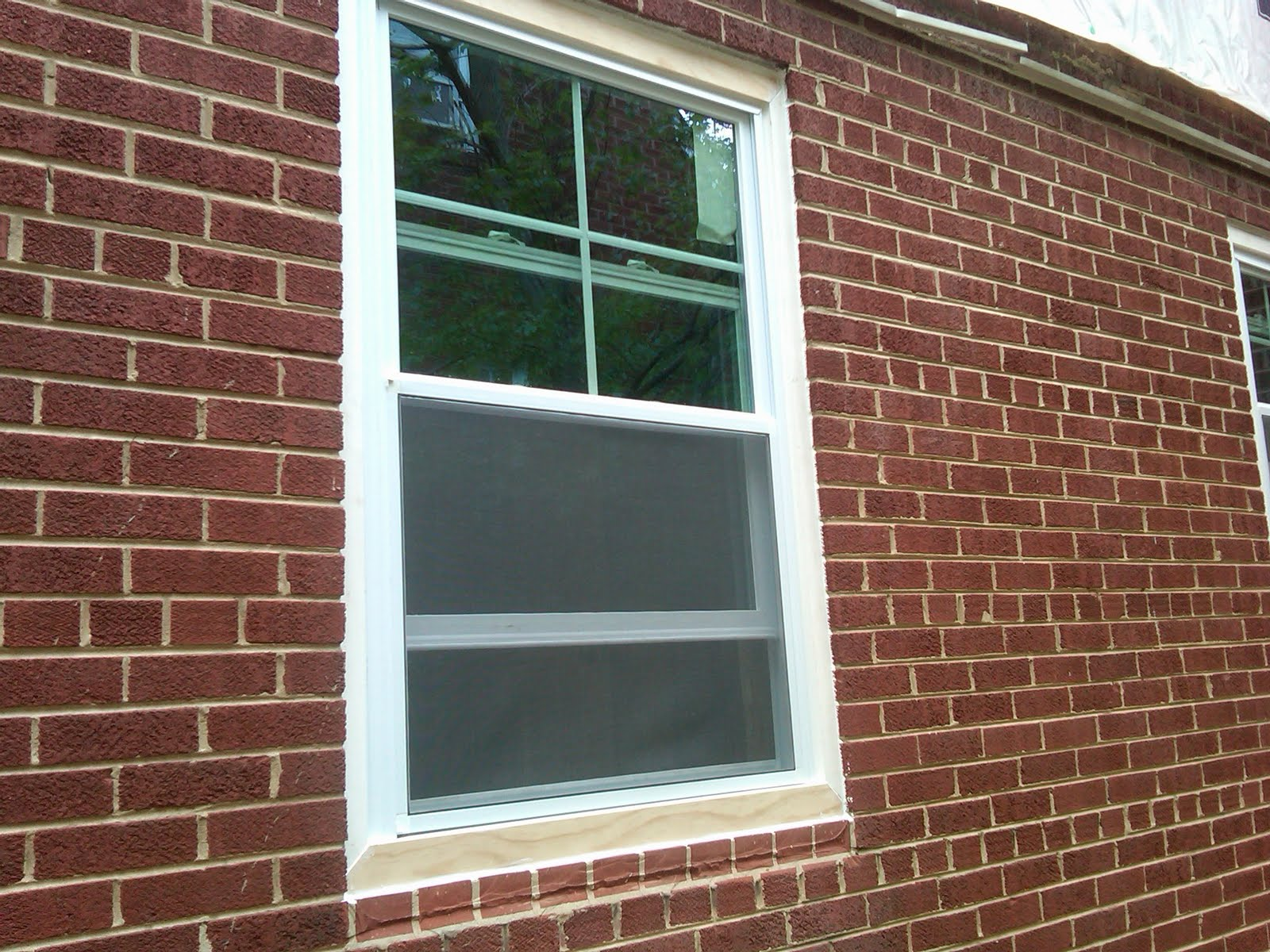 Exterior window trim - Trim The Outside And Then Caulk It To Make Sure It S All Water Tight We Used 1x2 And 1x3 To Trim This Out The Brick Sill Was Shaved Down To Make It