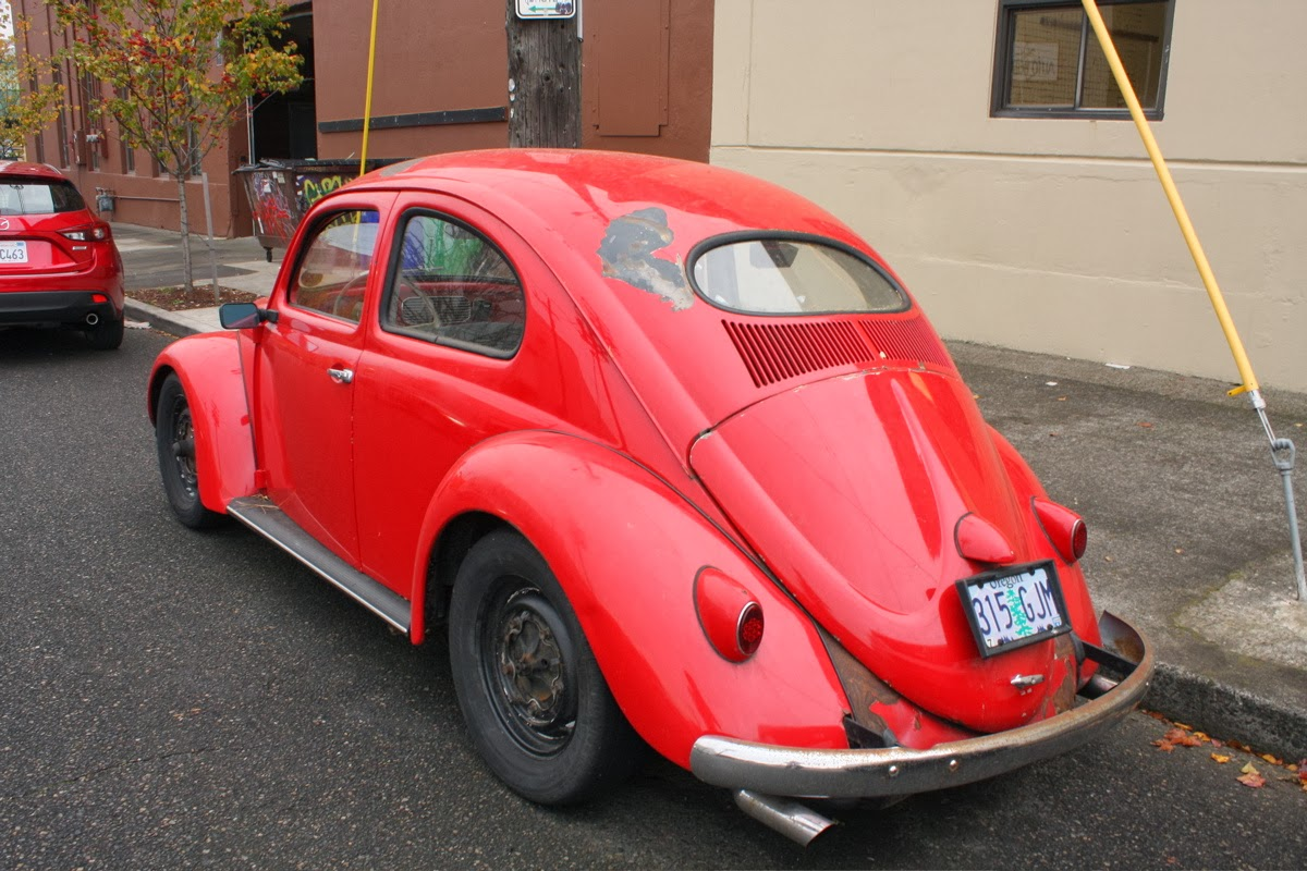 old parked cars oval window 1956 volkswagen beetle