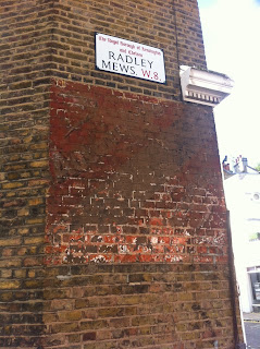 Ghost sign in Radley Mews, Kensington, London W8