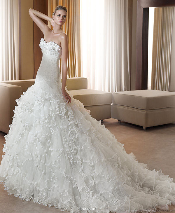 This Pronovias dress is a total stunner Ruffles and lace all in one