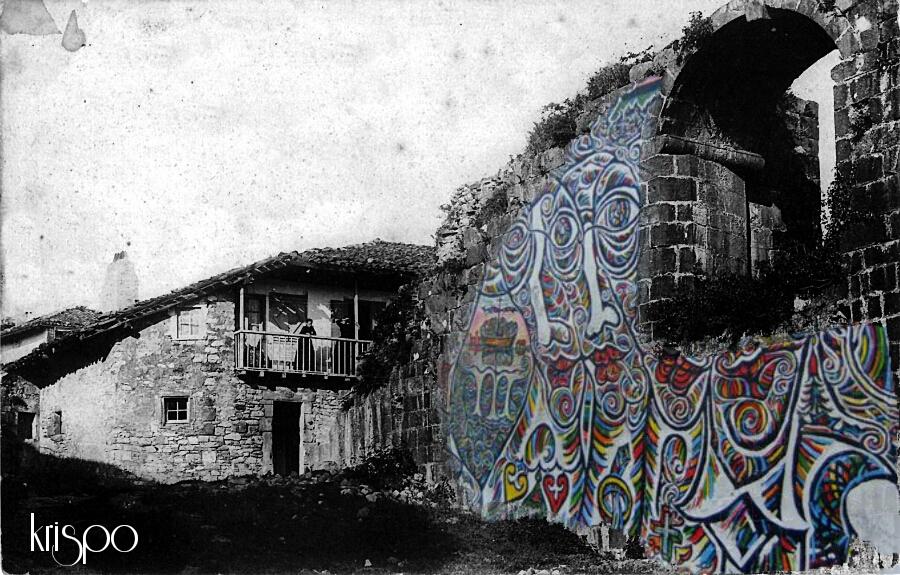 fotografia antigua de parte de un muro en hondarribia retocada con un mural