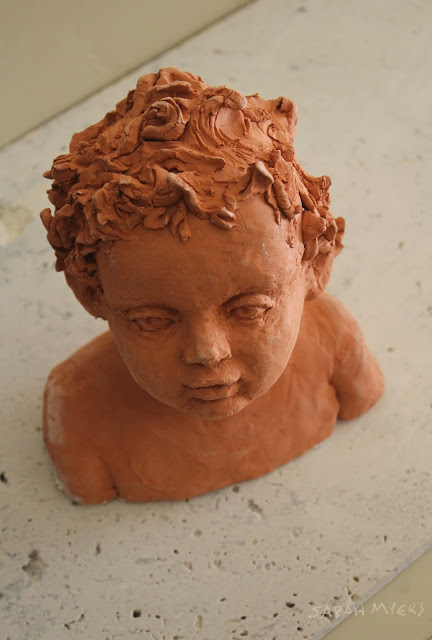 child, baby, sculpture, art, sarah myers, sarah, myers, head, infant, portrait, escultura, ceramica, arte, niño, earthenware, ceramic, terracotta, amy myers, eyes, glance, face, small, young, realistic, figurative, classic, classical, human, endearing, beautiful, darling, expectant, new, work, artwork, bust, red, upward, artist, mother, hair, above, angle, down
