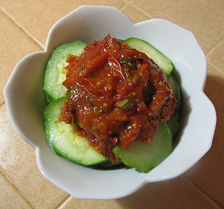Bowl of Tomato Sauce over Steamed Zucchini