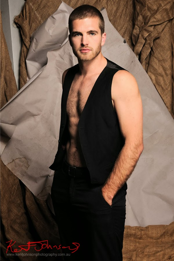 Body shot in the studio, men's fashion, suit vest and pants, studio as location. Male Modelling Portfolio - Photographed by Kent Johnson.