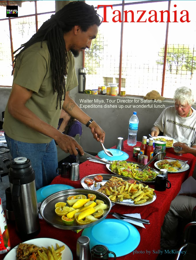 Walter Miya, Safari Arts Expeditions serving food. Photo Sally McKinney for TravelBoldly.com