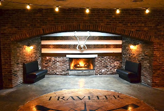 Traveler Montlake fireplace at the back of the restaurant