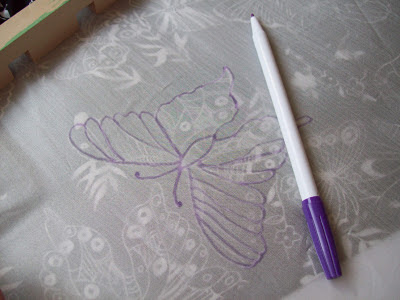 Sketching out the design with an autofade pen for silk painting