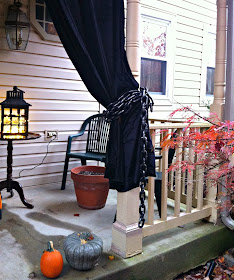 I tied back the curtains with some plastic chain.