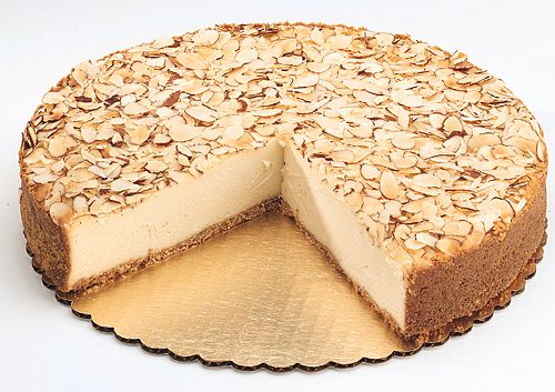 Place bits of almonds on top of the almond cheesecake and serve!