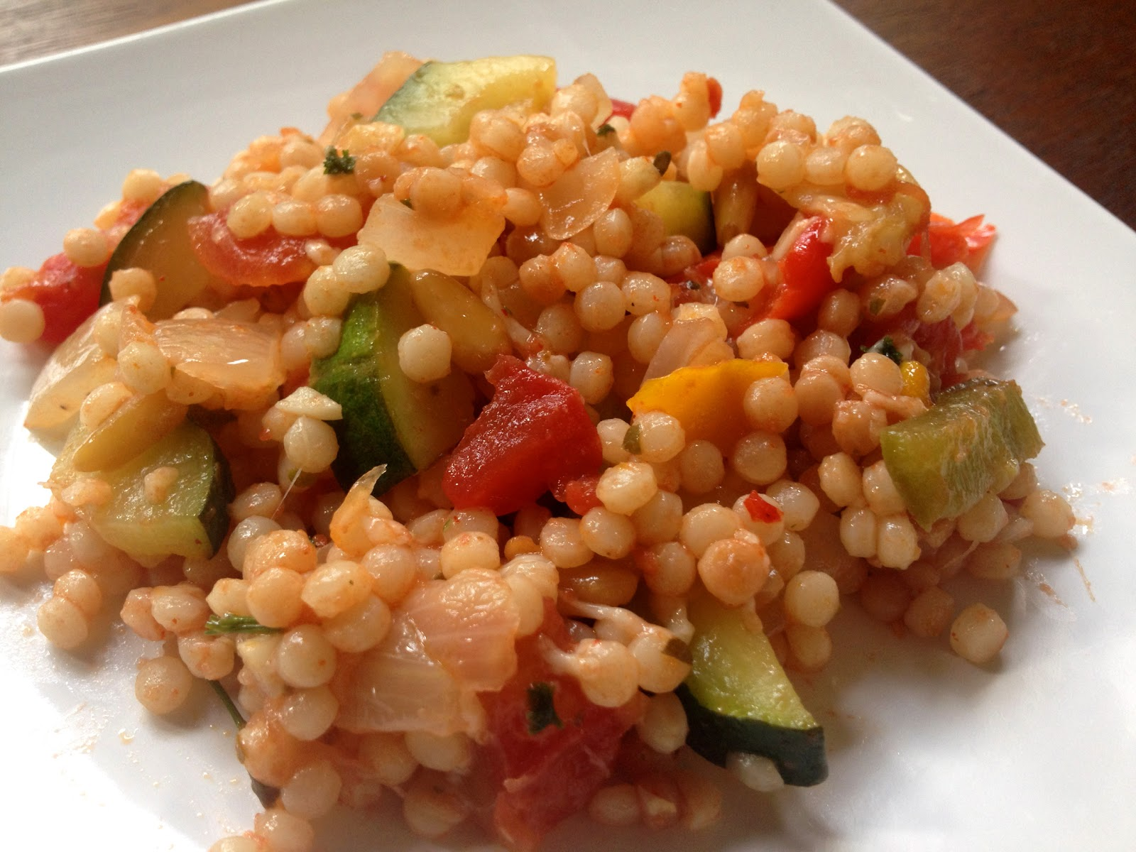 http://1.bp.blogspot.com/-MOsVrB4sU7g/UAIbyldpPBI/AAAAAAAABK4/zWftoQ4zr9U/s1600/ratatouille+with+pearled+couscous+zucchini+tomatoes+recipes+vegetarian+healthy+easy+italian+food+parmesan+cheese++recipes+for+extra+zucchini+israeli+couscous+ratatouille.jpg