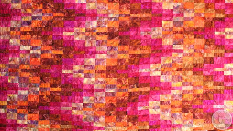 Colcha de patchwork con la técnica bargello