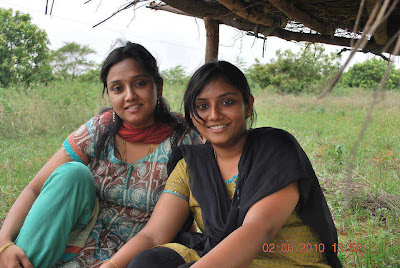 Tamil Nadu village girls sitting casually on the farm fields.