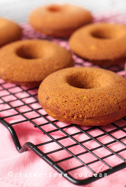 Gluten-free pumpkin donuts cooling, ready for sugaring