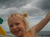 Kath at the beach, stormy day, but beautiful sunny smile.