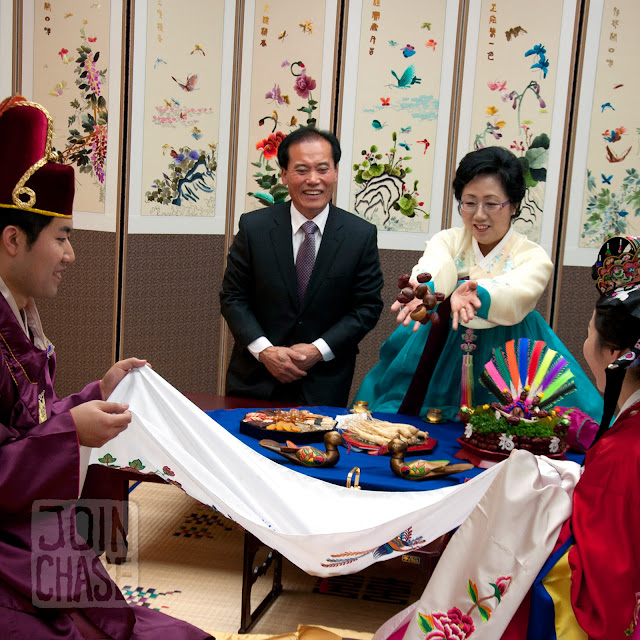 The groom's parents toss Chestnuts as a blessing for the newlyweds in Cheongju, South Korea.