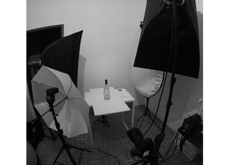setup shot of how to photograph glass bottles