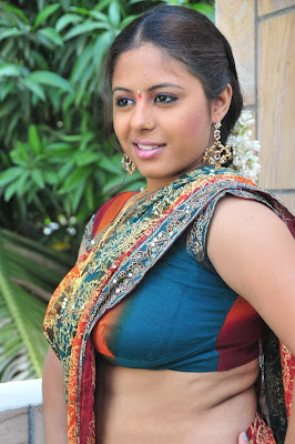 Hot and Spicy Actress Sunakshi in Hot Saree Blouse Navel Show Photos and stills