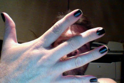 men wearing black nail polish